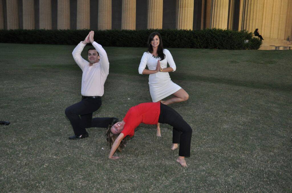 Reed PR employees doing yoga poses in Centennial Park