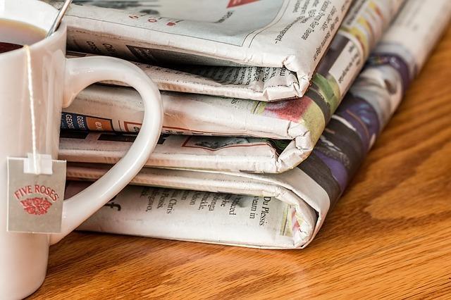 Newspapers with mug of Five Roses Tea