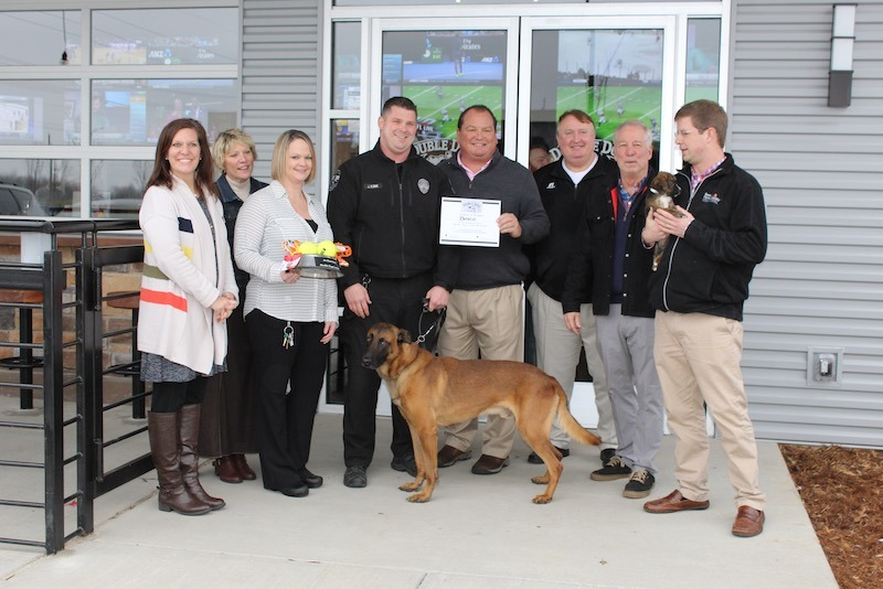 Grand Opening of Double Dogs Restaurant with a policer officer and K-9 service dog from the Metro Nashville Polic Department